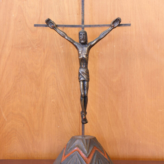 Cast Bronze with patina, polished highlights on copper cross with copper and enamel stand. 44cm H x 16cm W x 16cm D