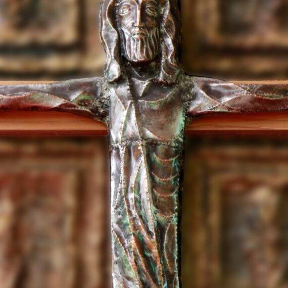 Copper Figure. Beaten copper with black oxide patina polished highlights. 150cmH x 130cmW . Wooden Cross 250cmH x 160cmW