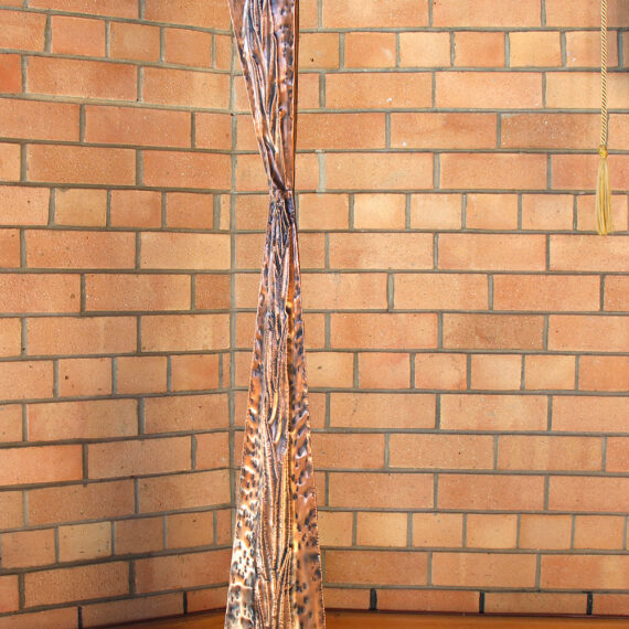 Beaten copper with black oxide patina polished highlights and lacquered. 135cm H x 16cm W x 16cm D