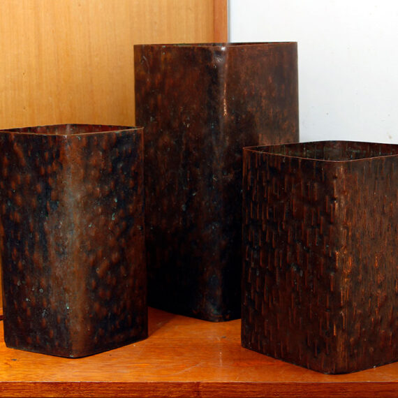 Beaten copper with black oxide patina polished highlights.