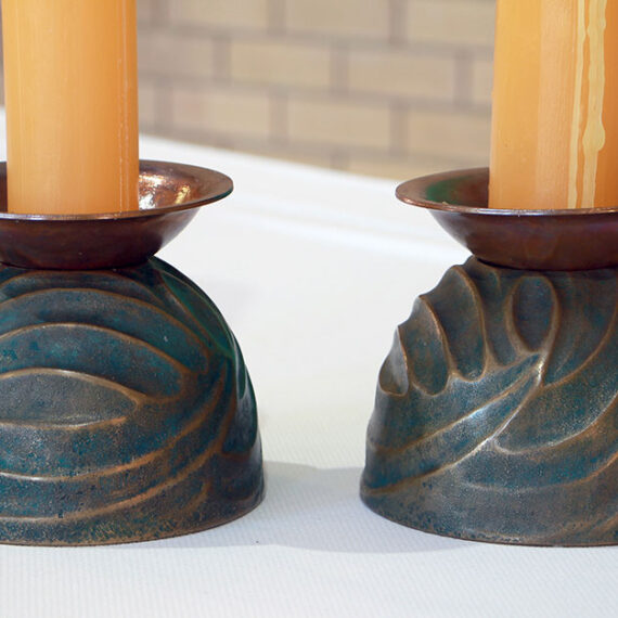 Cast Bronze with green oxide patina. 12cmH x 14cmW x 14cmD