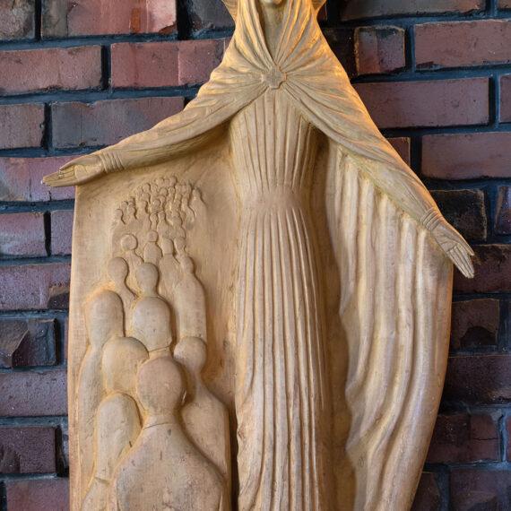 Carved wood. 110H x 65cmW x 15cmD